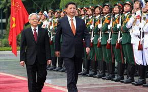习近平抵达河内对越南进行国事访问