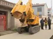 无人驾驶全自动挖树机中国农民造,和德国机械有一拼