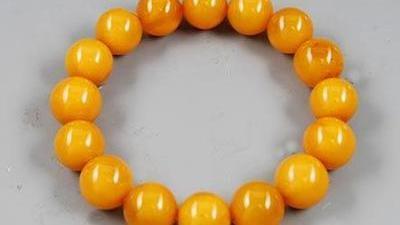 蜜蜡手串价值3万 巴林鸡血石质地欠缺